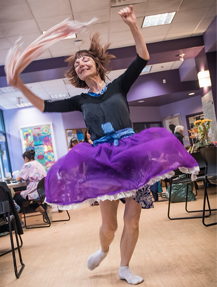 A woman dances joyfull and happilly at the end of an event