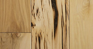Close up of character grade hickory hardwood flooring planks.jpg