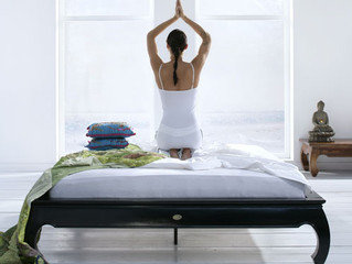 Reduce low back pain with these 5 yoga postures in your bed