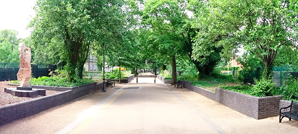 Trees canopy over Leicester New Walk pedestrianised walkway