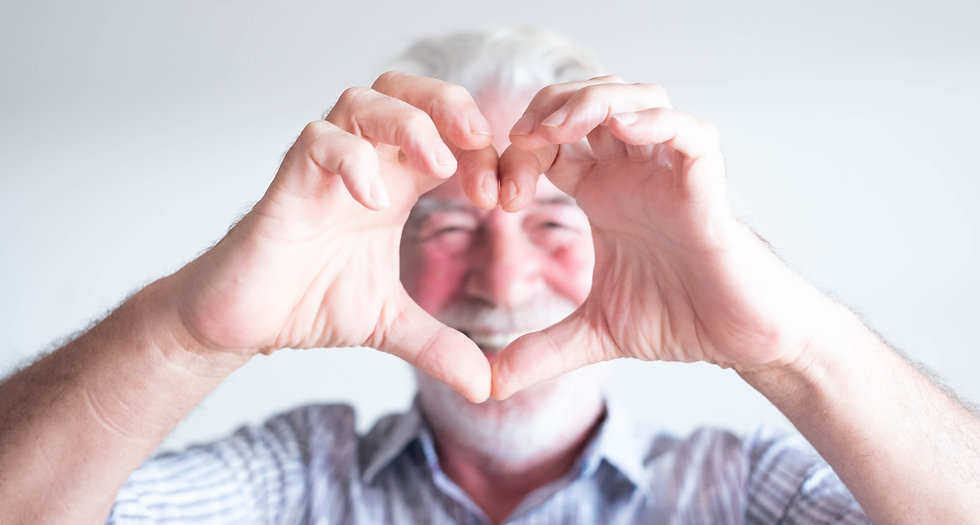 close up and portrait of mature man and senior doing an heart with his fingers and hand in front of