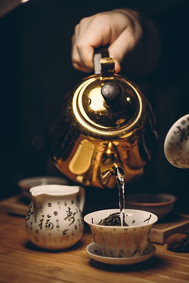 Canva - Person Holding Gold Teapot Pouri