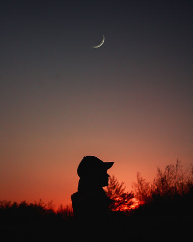 Canva - Silhouette of Person Wearing Cap