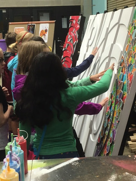 Students touching Penn Artwork.JPG