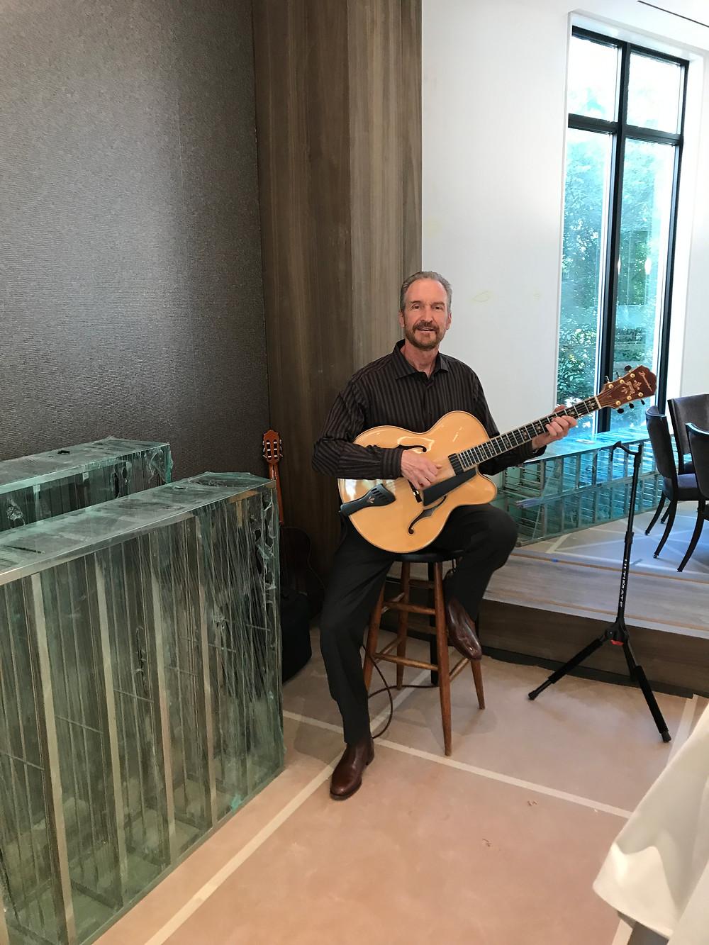 guitarist for Dallas real estate event