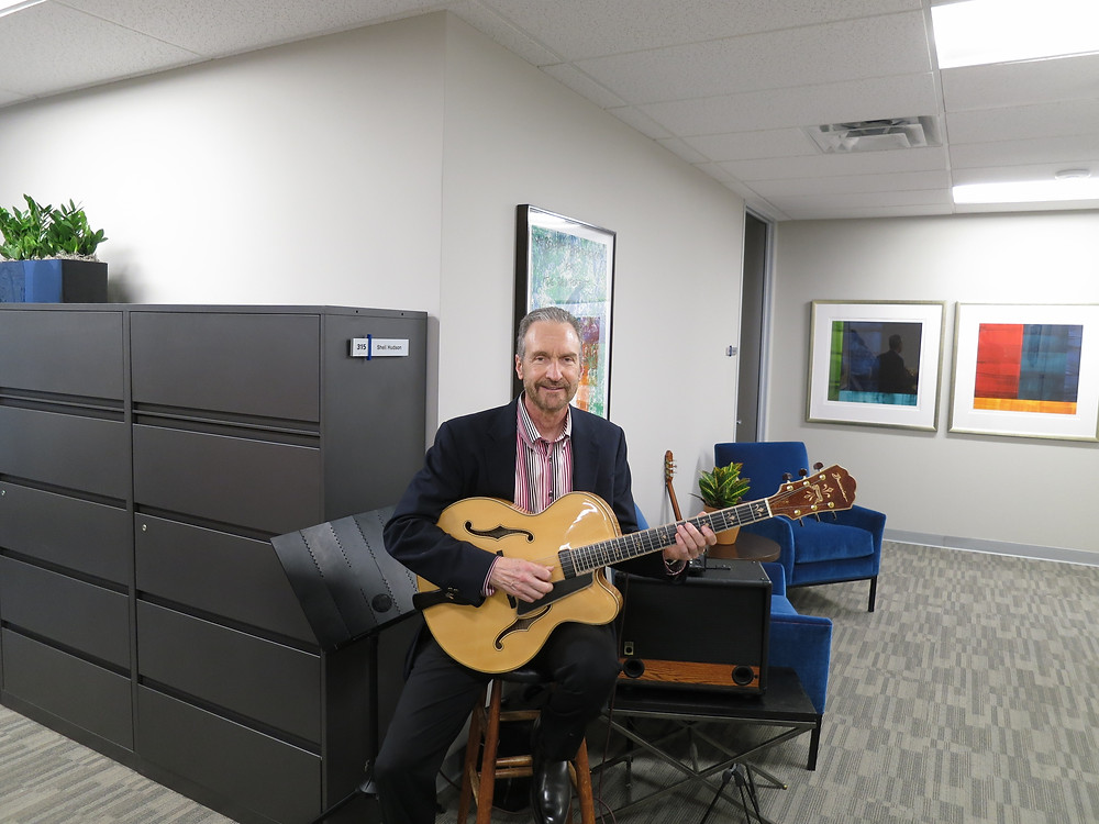 Guitarist for open house event