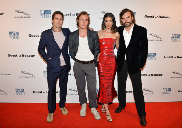 Alexandre Bourgeois posing with the rest of the Guest of Honour cast on the red carpet for TIFF 2019