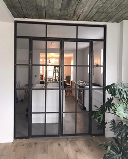Industrial bedroom wall and french doors