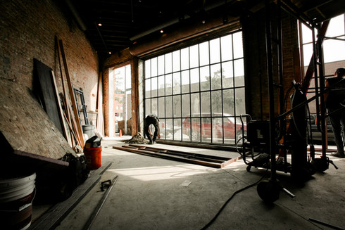 Large Exterior Steel and Glass Wall for a warehouse to home renovation.