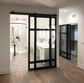 Sliding Steel and Glass Doors for a Bathroom and Closet
