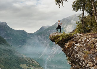 woman-standing-on-the-cliff-1374064.jpg