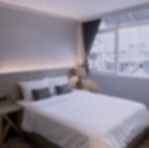 Comfortable bed at Maxim's Inn, heart of Bangkok