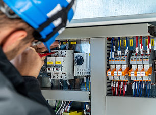 A engineer repairing electrical installa