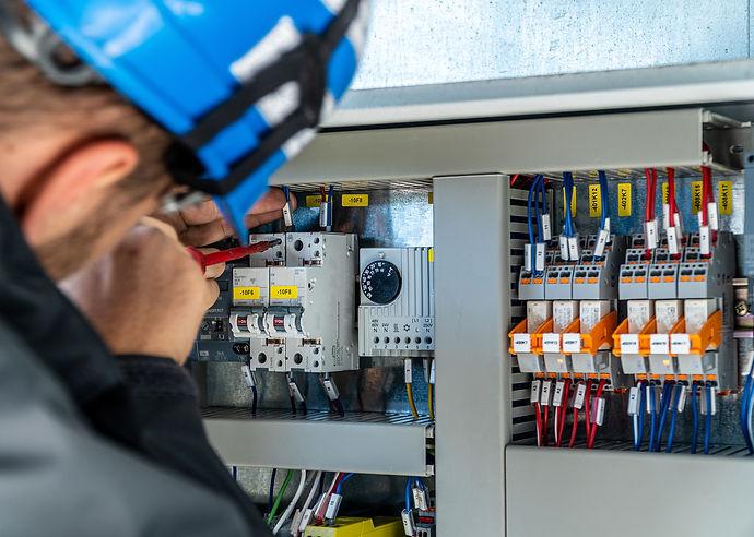 A engineer repairing electrical installa