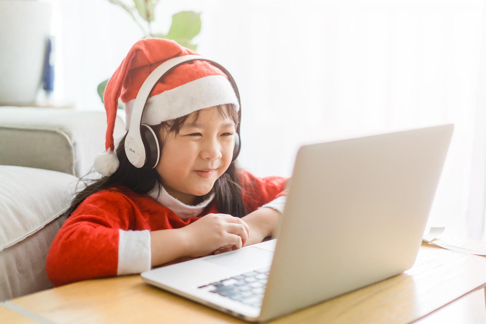 Asian girl with santa hat on christmas h