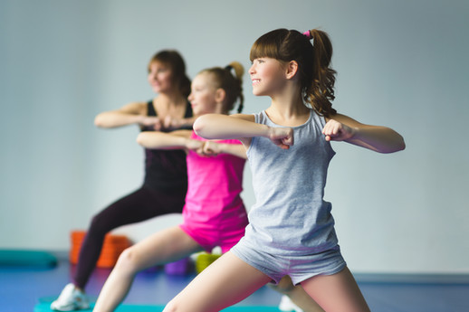 Girls and Instructor or mother doing gym