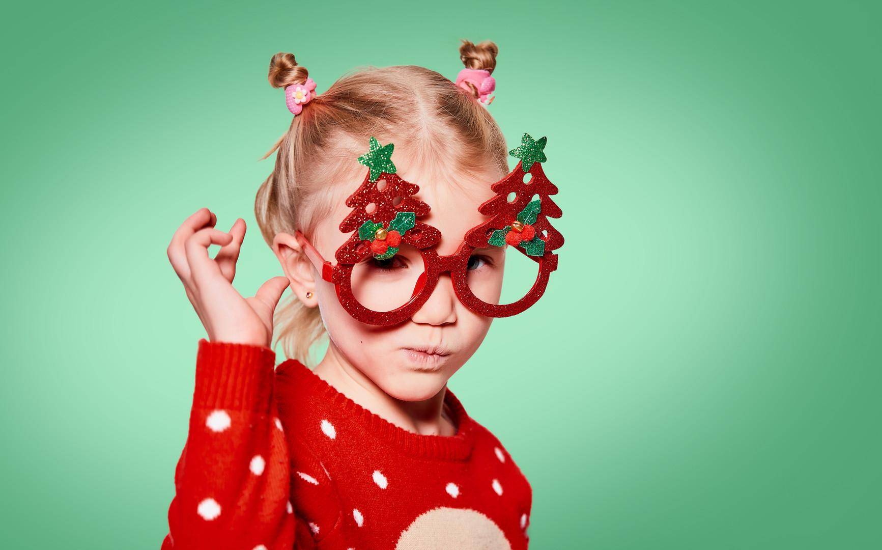 Funny blond little girl wearing red chri