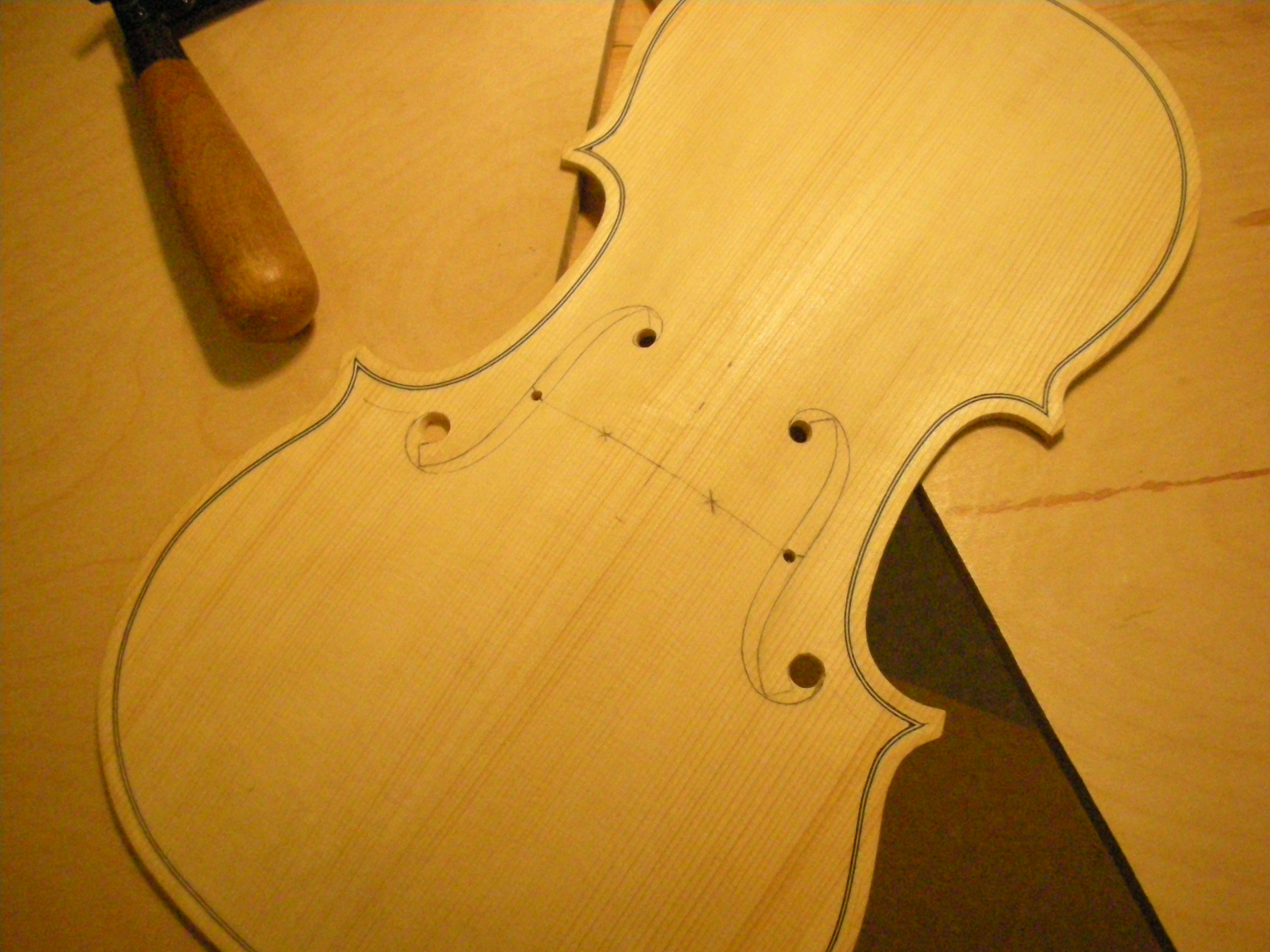 violin F-holes being carved