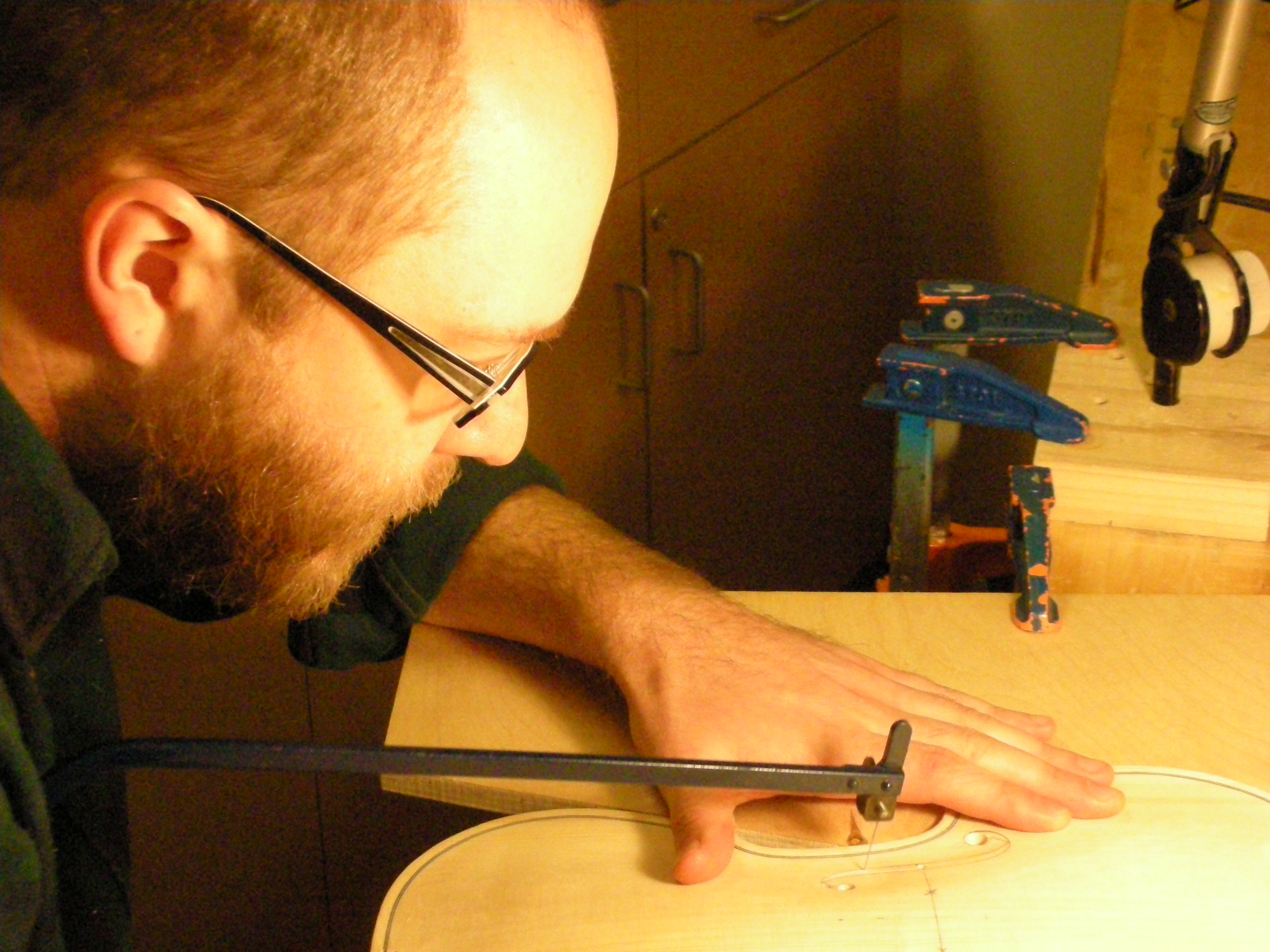 luthier cutting f-holes