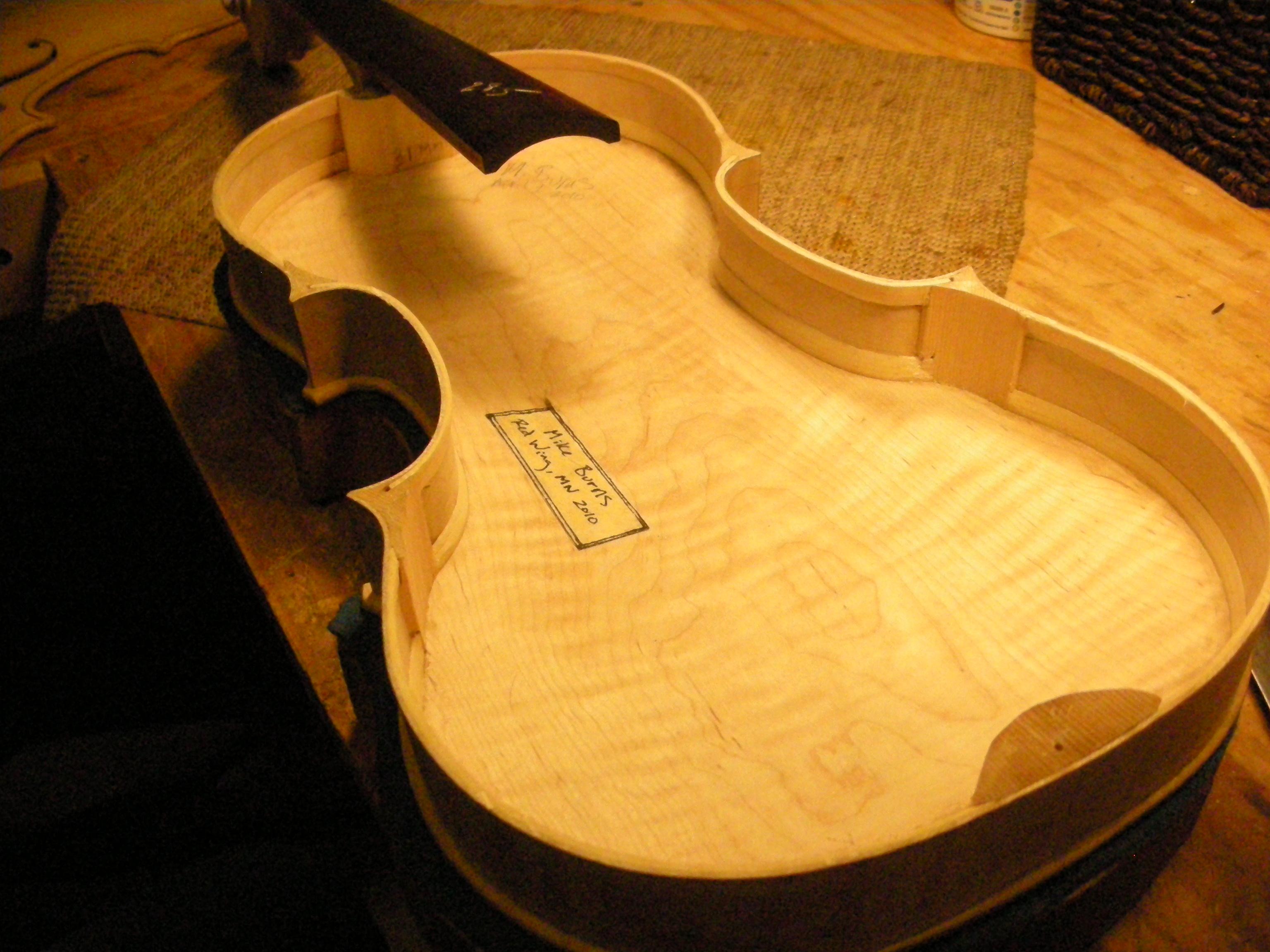 preparing to close new violin box