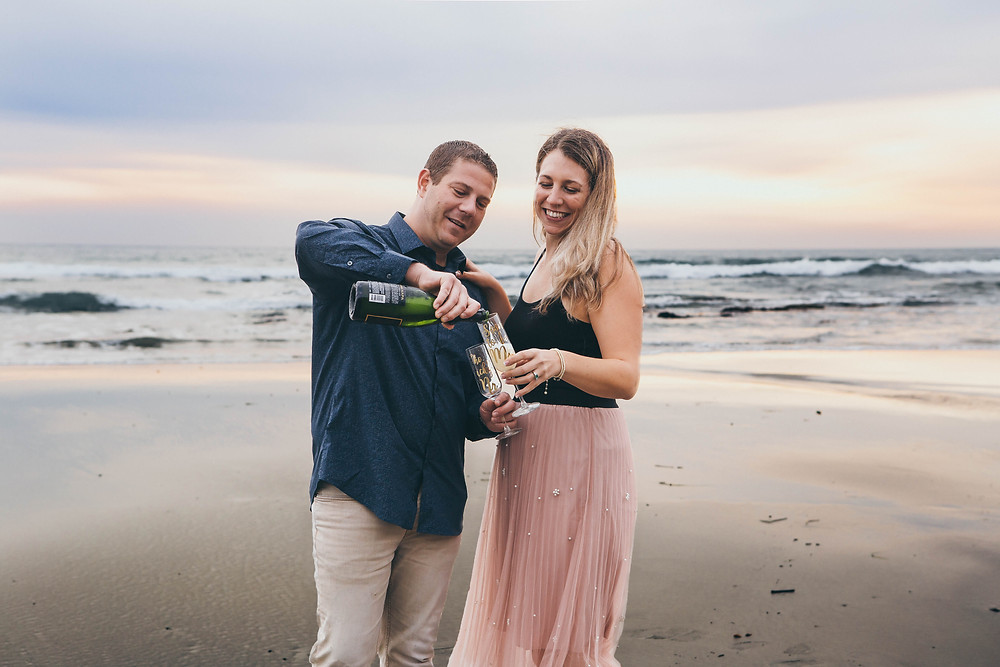 Cheers, champagne on the beach for engagement