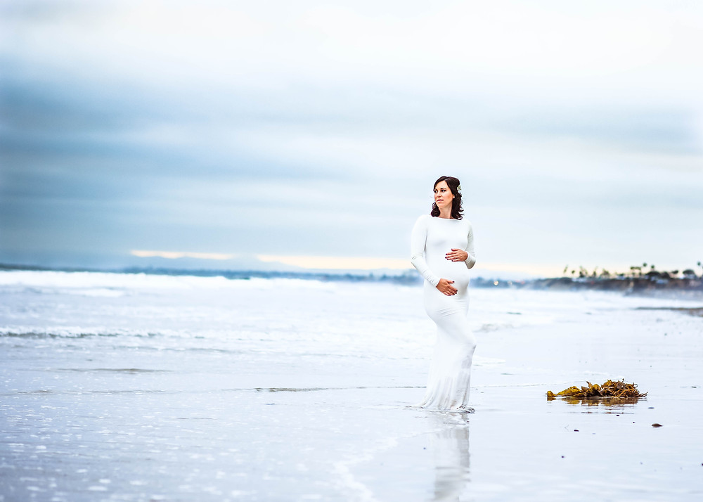 Maternity photos on the beach in white