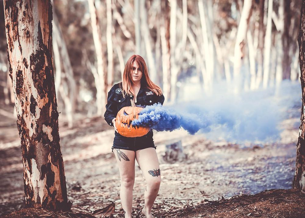 Smoke bomb in pumpkin, spooky blair witch type photo