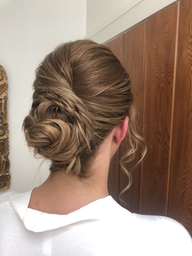 Textured, twisted pulled back chignon for long, thin-medium hair.