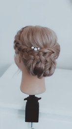 Classic twisted chignon with a braid.