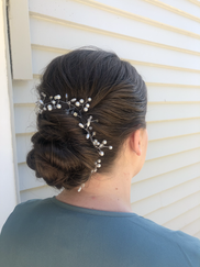 Dreamy bridesmaid twisted chignon with hair piece (provided by client) on thick medium length layered hair.