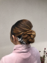 High volume twisted and braided chignon on thick, bleached asian hair.