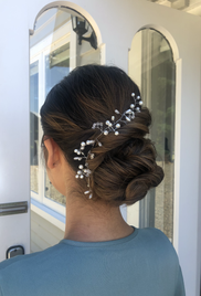 Dreamy bridesmaid twisted chignon with hair piece (provided by client) on thick, bleached, medium length asian hair.