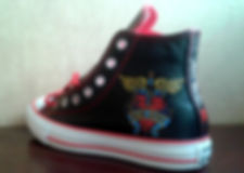 Bon Jovi painted shoes by award winning animal and pet portrait artist Frances Vincent. Artist based in Suffolk