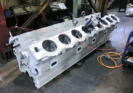 V16 engine block being VSR Processed