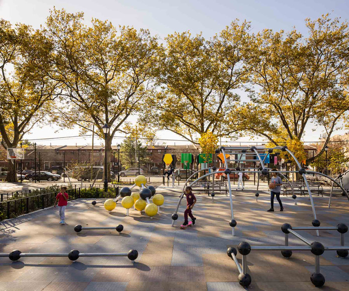 This view looking west highlights the parkour course in the foreground; an imaginative and dynamic way for teenagers and adults to exercise. Large trees along the park's perimeter were preserved and provide valuable shade and seasonal color for visitors.