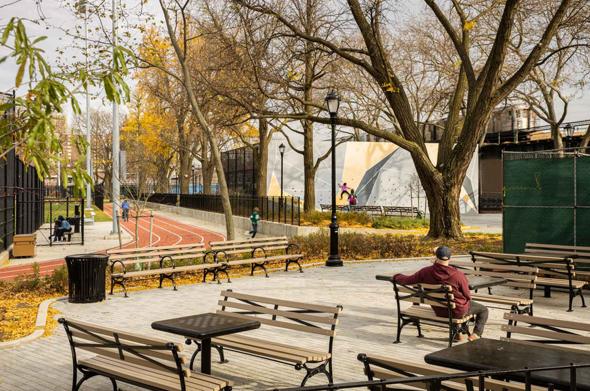 The site's program and circulation are carefully and strategically weaved amongst existing mature trees. Granite checkers and domino tables serve an older population who frequent the park for these beloved activities.
