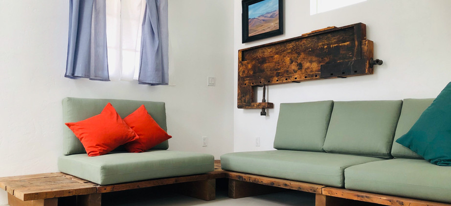 Platform couch and wall art