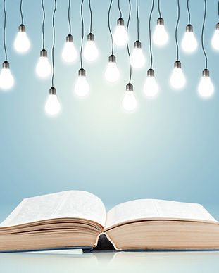 Open book with shining lamps.jpg