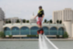 Ryan, up close with the Monona Terrace.  Flyboarding, Madison, Wisconsin.