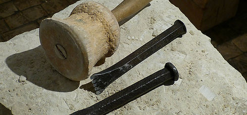 Stone supply for new built stone - piece of stone with stonemason tools
