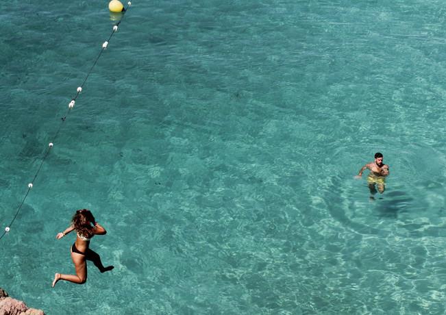 Cliff diving at Cala Saladeta