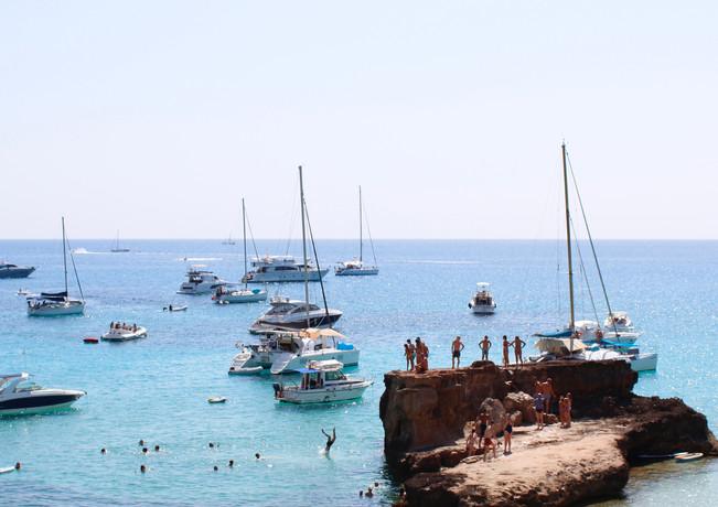 Cliff jumping at Cala Tarida