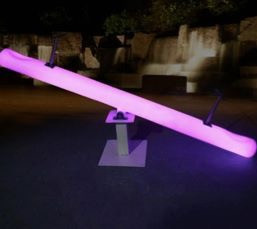 White Seesaws that can be lit to display any color.