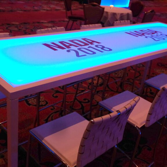 White tables that can be used to display any color glow or without glow.