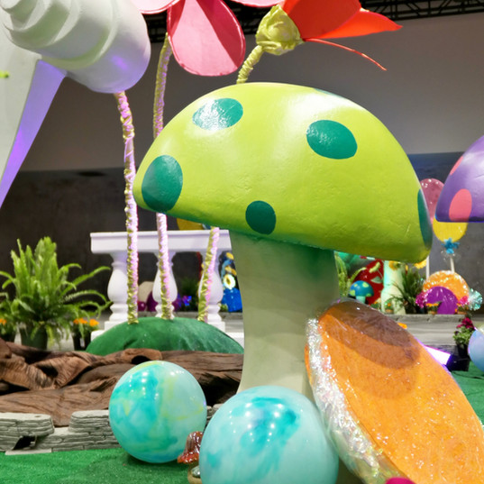 Oversized mushrooms, flowers, and varying candy