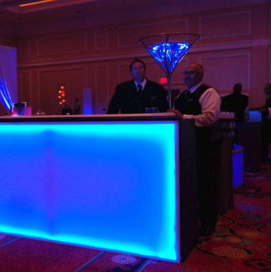 White bar that can be lit to display any color.