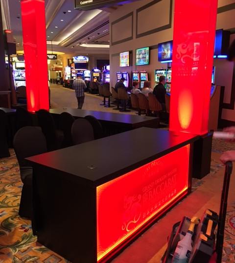 Black registration tables that can be lit to display any color.