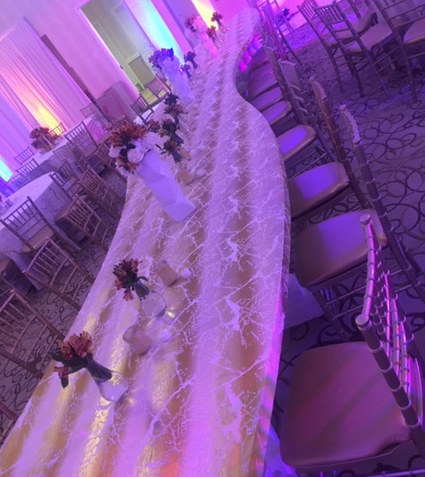 Curved serpentine tables