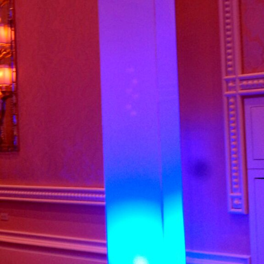 White columns that can be lit to display any color.