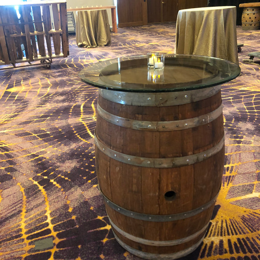 Barrel tables with glass tops